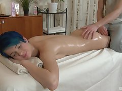 Amazing and oiled Amy Frost enjoys lovemaking on the massage table