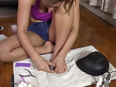 Brunette teen Davina Davis getting a pedicure