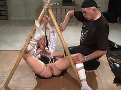 Submissive chick endures repeatedly of pussy clamping and bondage sex